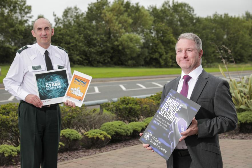 PSNI and head of NI Cyber security centre holding advice guide